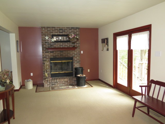 Living Room With Fireplace and Deck Door