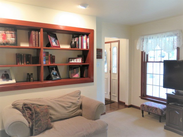 Den With Built In Cherry Display Shelving
