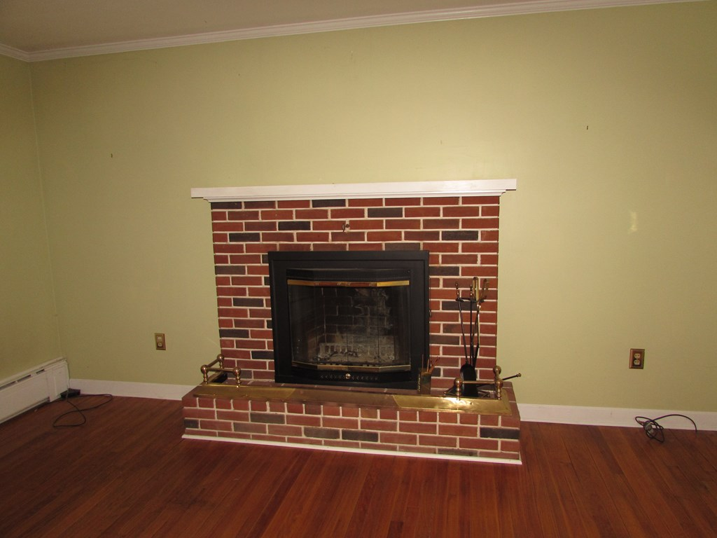 Brick fireplace in living area