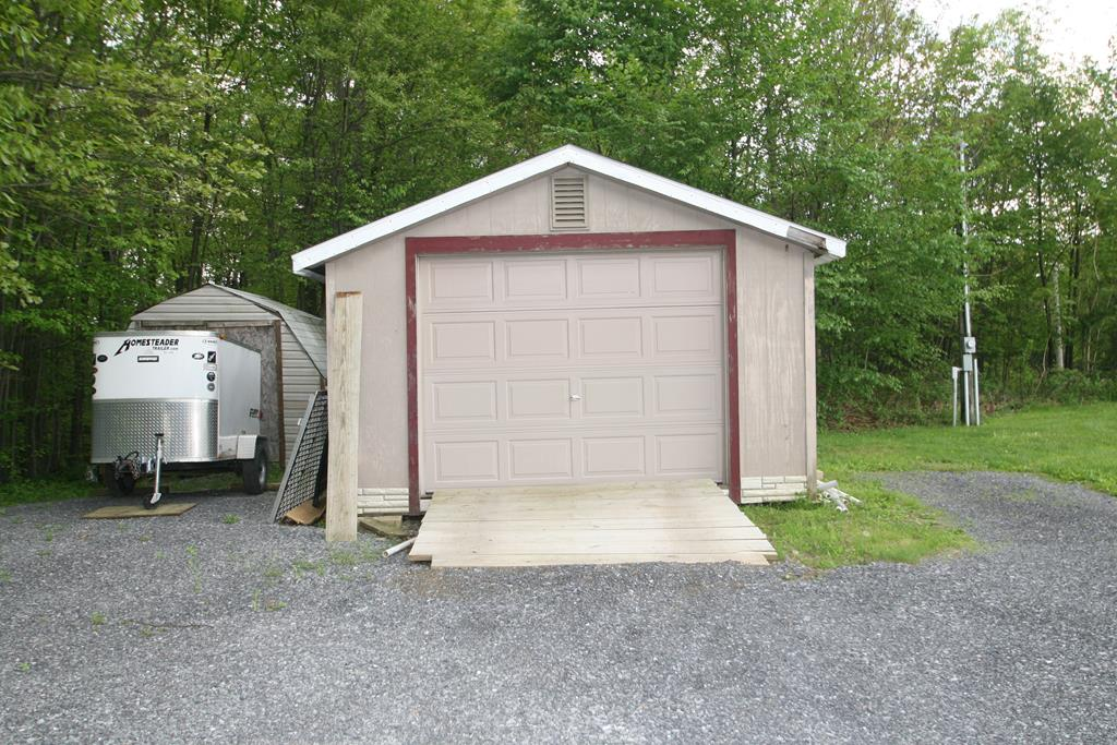 One Car Garage and Garden Shed